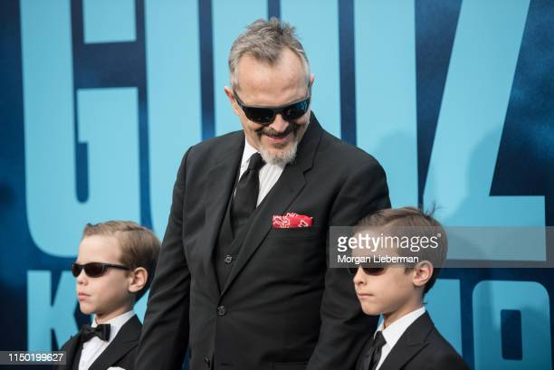 Miguel Bose and sons Diego and Tadeo arrive at the premiere Of Warner Bros Pictures And Legendary Pictures' Godzilla King Of The Monsters at TCL...