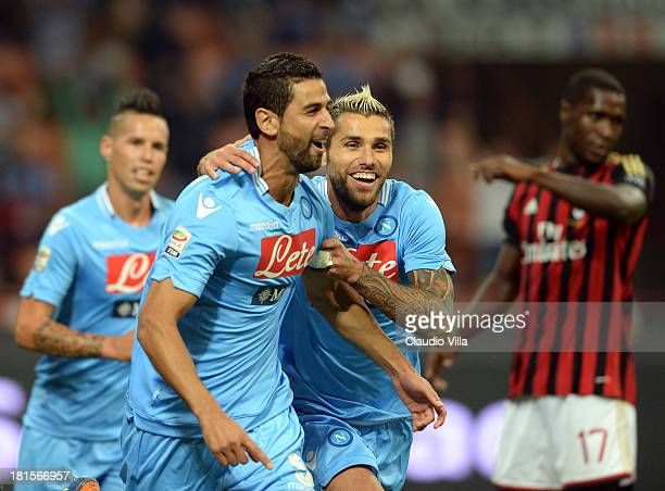 Miguel Britos of SSC Napoli celebrates scoring the first goal during the Serie A match between AC Milan and SSC Napoli at San Siro Stadium on...
