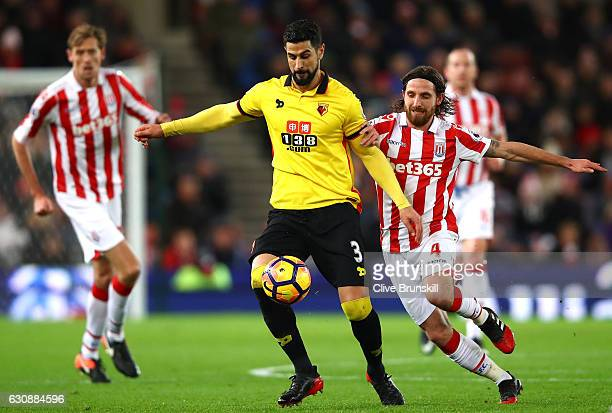 Miguel Britos of Watford and Joe Allen of Stoke City compete for the ball during the Premier League match between Stoke City and Watford at Bet365...