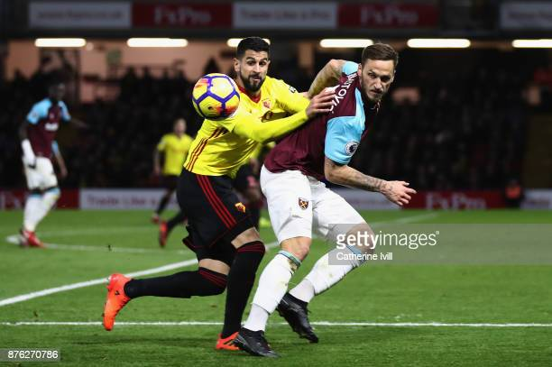 Miguel Britos of Watford and Marko Arnautovic of West Ham United watch the ball during the Premier League match between Watford and West Ham United...