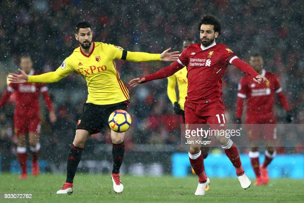 Miguel Britos of Watford and Mohamed Salah of Liverpool battle for the ball during the Premier League match between Liverpool and Watford at Anfield...