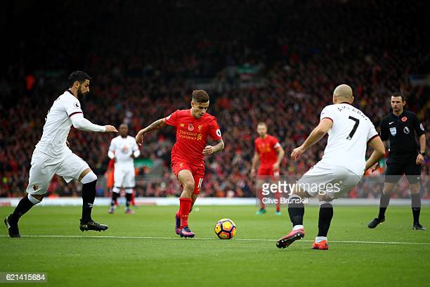 Miguel Britos of Watford and Nordin Amrabat of Watford close down Philippe Coutinho of Liverpool during the Premier League match between Liverpool...