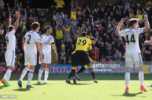 Miguel Britos of Watford celebrates scoring his sides first goal with Etienne Capoue of Watford during the Premier League match between Watford and...