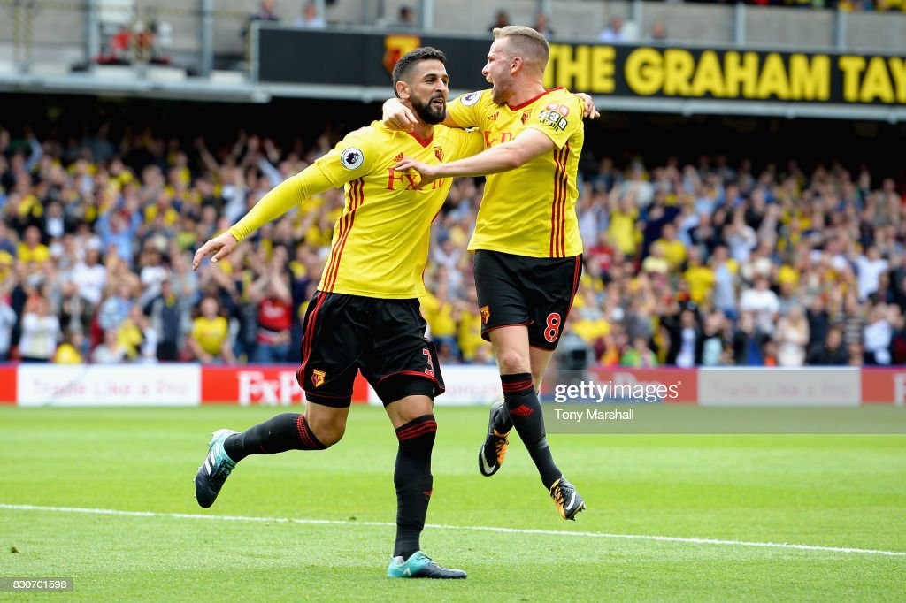 Miguel Britos of Watford celebrates scoring his sides third goal with Tom Cleverley of Watford during the Premier League match between Watford and Liverpool at Vicarage Road on August 12, 2017 in Watford, England.
