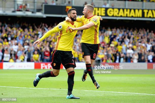 Miguel Britos of Watford celebrates scoring his sides third goal with Tom Cleverley of Watford during the Premier League match between Watford and...