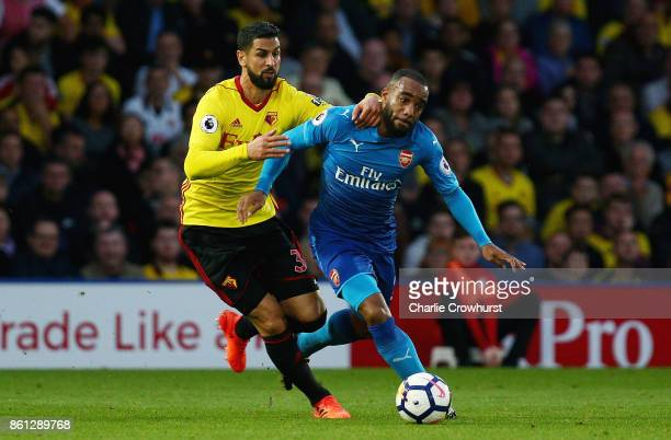 Miguel Britos of Watford chases down Alexandre Lacazette of Arsenal during the Premier League match between Watford and Arsenal at Vicarage Road on...