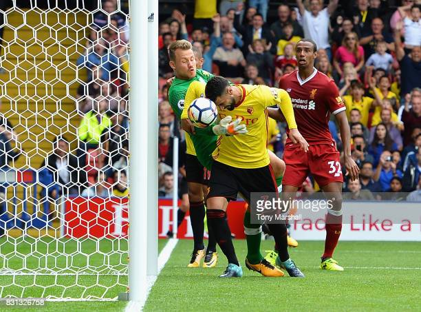 Miguel Britos of Watford heads the ball to score their third goal during the Premier League match between Watford and Liverpool at Vicarage Road on...