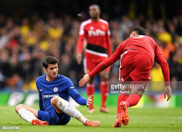 Miguel Britos of Watford helps up Alvaro Morata of Chelsea during the Premier League match between Chelsea and Watford at Stamford Bridge on October...
