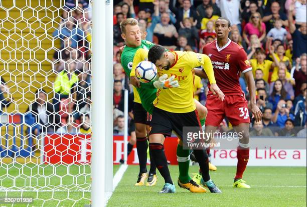 Miguel Britos of Watford scores his sides third goal past Simon Mignolet of Liverpool during the Premier League match between Watford and Liverpool...