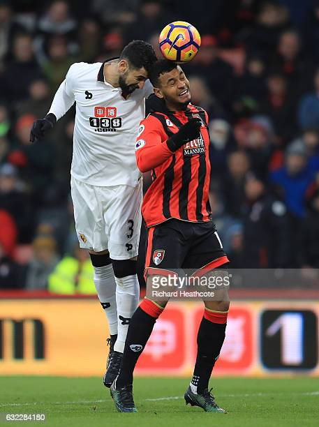 Miguel Britos of Watford wins a header over Joshua King of AFC Bournemouth during the Premier League match between AFC Bournemouth and Watford at...