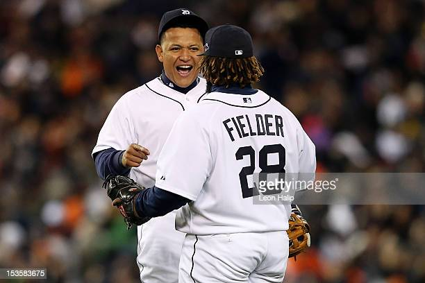 Miguel Cabrera and Prince Fielder of the Detroit Tigers celebrate after they won 31 against the Oakland Athletics during Game One of the American...