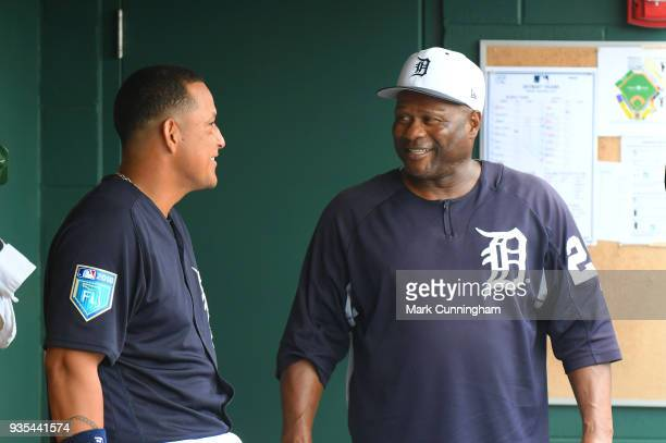 Miguel Cabrera and hitting coach Lloyd McClendon of the Detroit Tigers talk in the dugout during the Spring Training game against the New York...