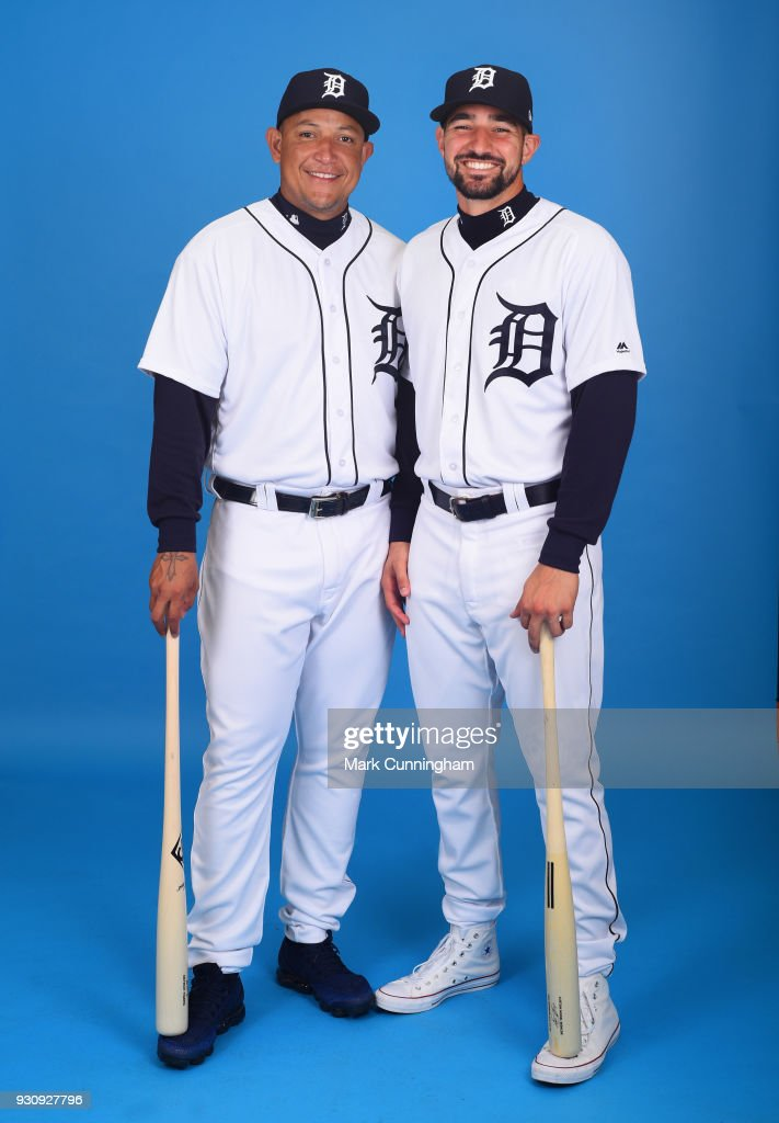 Miguel Cabrera #24 (L) and Nicholas Castellanos #9 of the Detroit Tigers pose for a photo during photo day on February 20, 2018 in Lakeland, Florida.