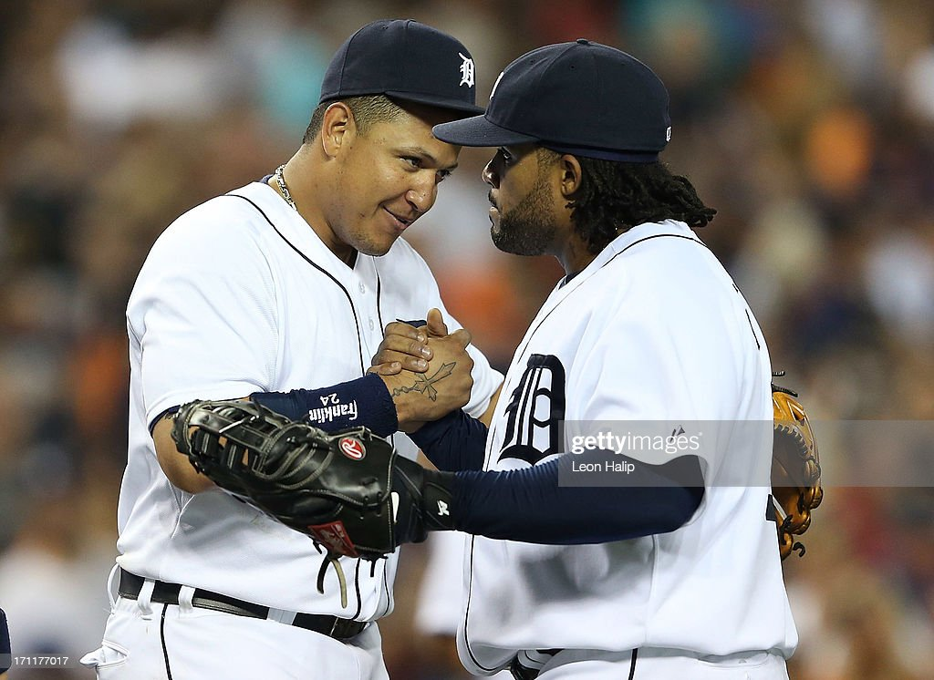 Miguel Cabrera #24 and Prince Fielder #28 of the Detroit Tigers celebrate a win over the Boston Red Sox at Comerica Park on June 22, 2013 in Detroit, Michigan. The Tigers defeated the Red Sox 10-3.