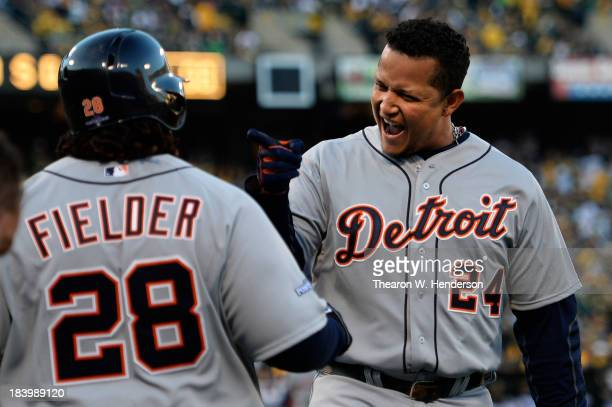 Miguel Cabrera celebrates his two-run home run with Prince Fielder of the Detroit Tigers in the fourth inning against the Oakland Athletics during...