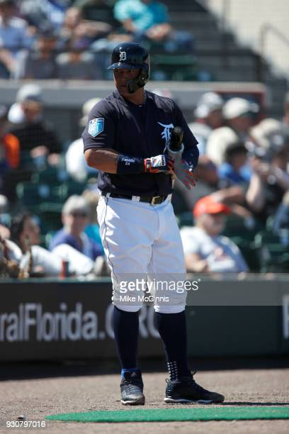 Miguel Cabrera of Detroit Tigers puts on his Franklin batting gloves during the Spring Training game against the New York Mets at Joker Marchant...
