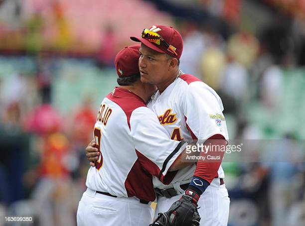 Miguel Cabrera of Team Venezuela hugs manager Luis Sojo after defeating Team Spain in Pool C Game 5 in the first round of the 2013 World Baseball...