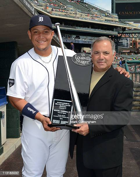 Miguel Cabrera of the Detroit Tigers and Tigers vice president and assistant general manager Al Avila pose for a photo with Cabreras 2010 Louisville...