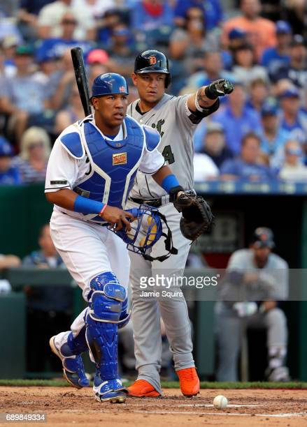 Miguel Cabrera of the Detroit Tigers appeals to the first base umpire for a call as catcher Salvador Perez of the Kansas City Royals looks on during...