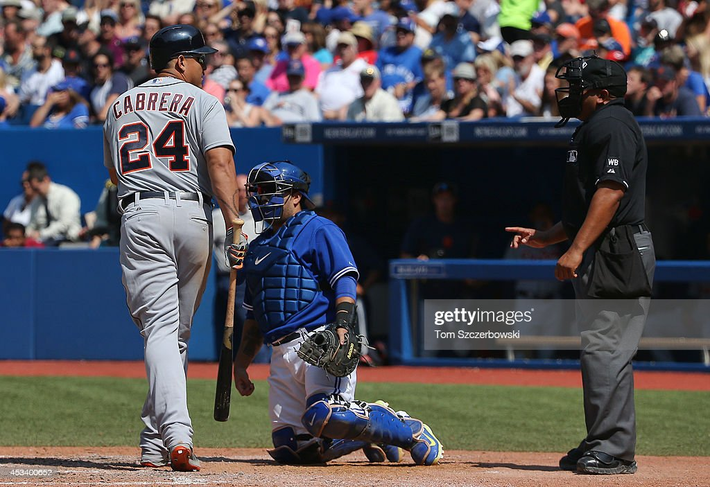 Miguel Cabrera #24 of the Detroit Tigers argues with home plate umpire Adrian Johnson #80 after being called out on strikes in the ninth inning during MLB game action against the Toronto Blue Jays on August 9, 2014 at Rogers Centre in Toronto, Ontario, Canada.