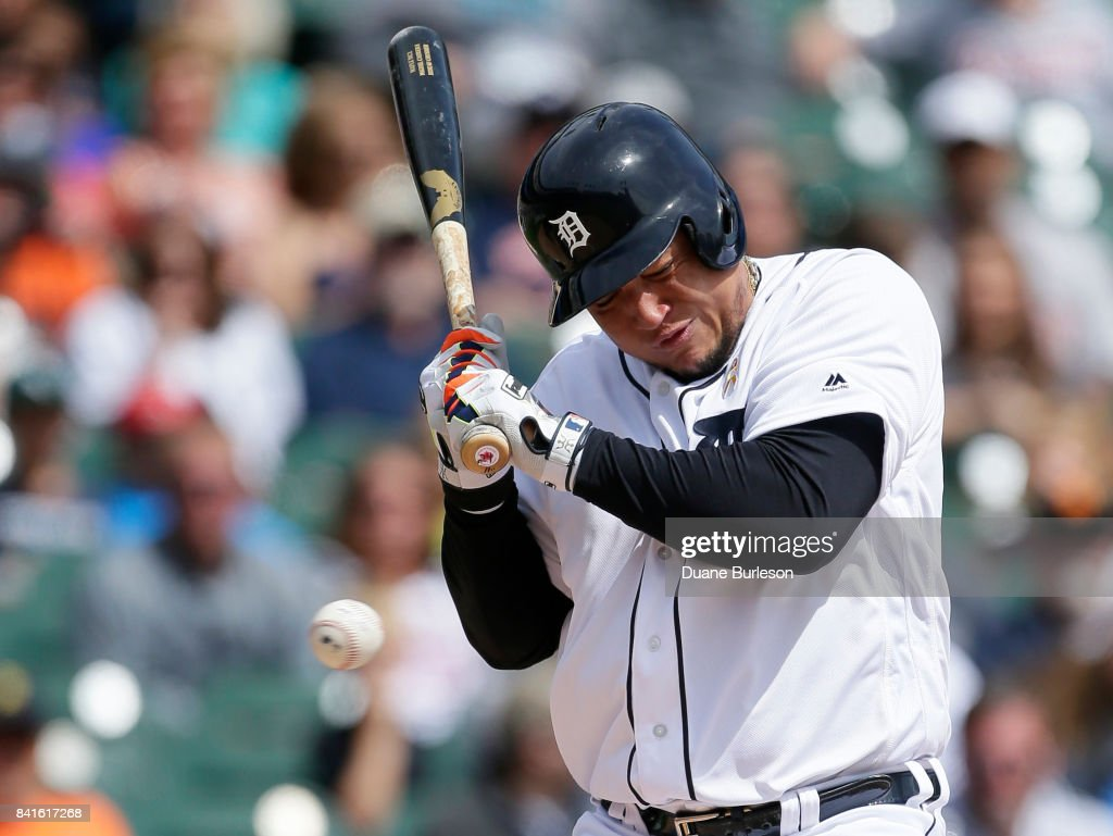 Miguel Cabrera #24 of the Detroit Tigers avoids an inside pitch from Carlos Carrasco of the Cleveland Indians during the first inning of game one of a doubleheader at Comerica Park on September 1, 2017 in Detroit, Michigan.