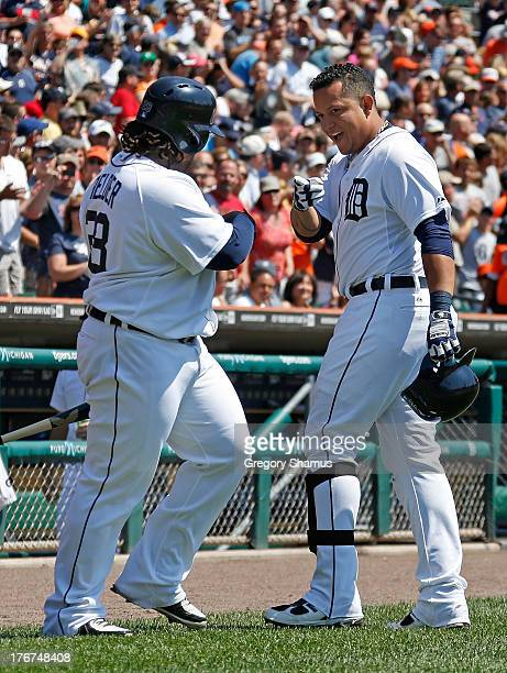 Miguel Cabrera of the Detroit Tigers celebrates a first inning home run with Prince Fielder while playing the Kansas City Royals at Comerica Park on...