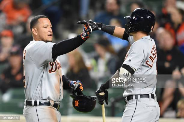 Miguel Cabrera of the Detroit Tigers celebrates a three run home run in the second inning with Nicholas Castellanos during a baseball game against...