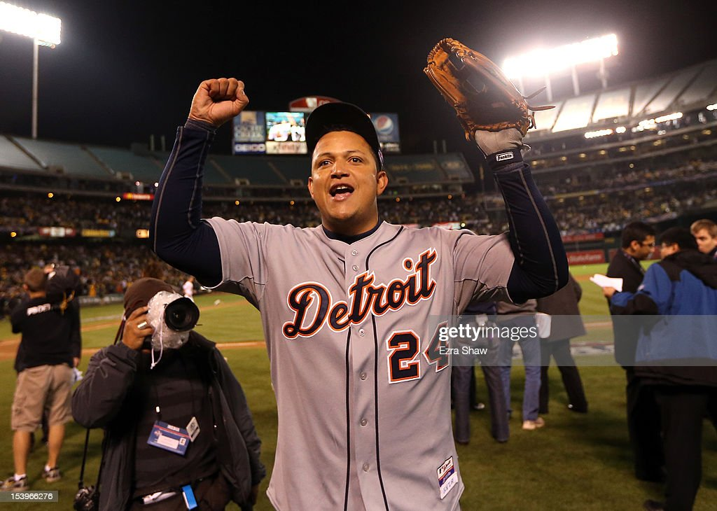 Miguel Cabrera #24 of the Detroit Tigers celebrates as he walks off the field after the Detroit Tigers beat the Oakland Athletics in Game Five of the American League Division Series at Oakland-Alameda County Coliseum on October 9, 2012 in Oakland, California.