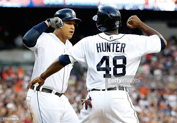 Miguel Cabrera of the Detroit Tigers celebrates his fifthinning threerun home run with Torii Hunter against the Boston Red Sox at Comerica Park on...