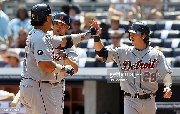 Miguel Cabrera of the Detroit Tigers celebrates his first inning two run home run against the New York Yankees with teammates Johnny Damon and Will...