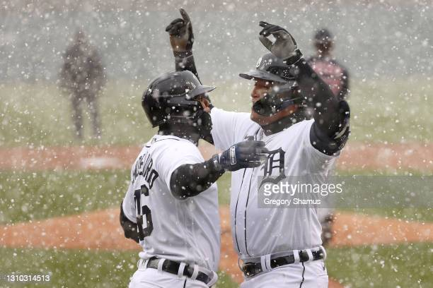 Miguel Cabrera of the Detroit Tigers celebrates his first inning two run home run with Jeimer Candelario of the Detroit Tigers while playing the...