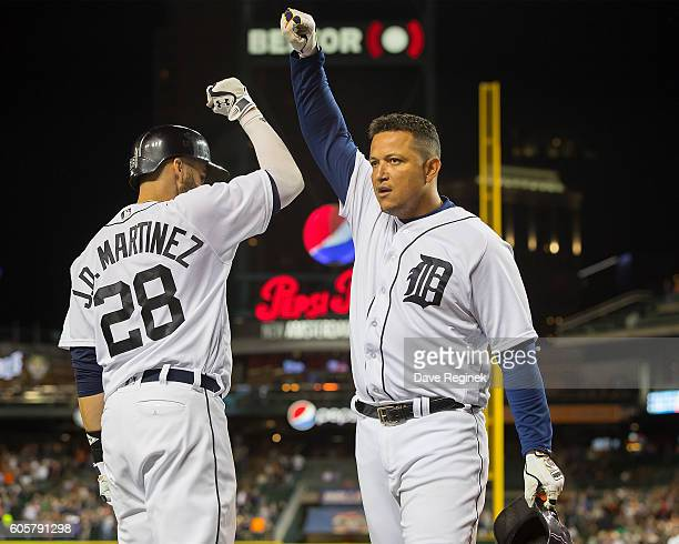 Miguel Cabrera of the Detroit Tigers celebrates his seventhinning solo home run with teammate JD Martinez during a MLB game against the Minnesota...