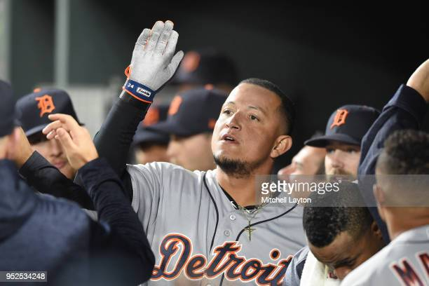 Miguel Cabrera of the Detroit Tigers celebrates hitting a three run home run in the second inning during a baseball game against the Baltimore...