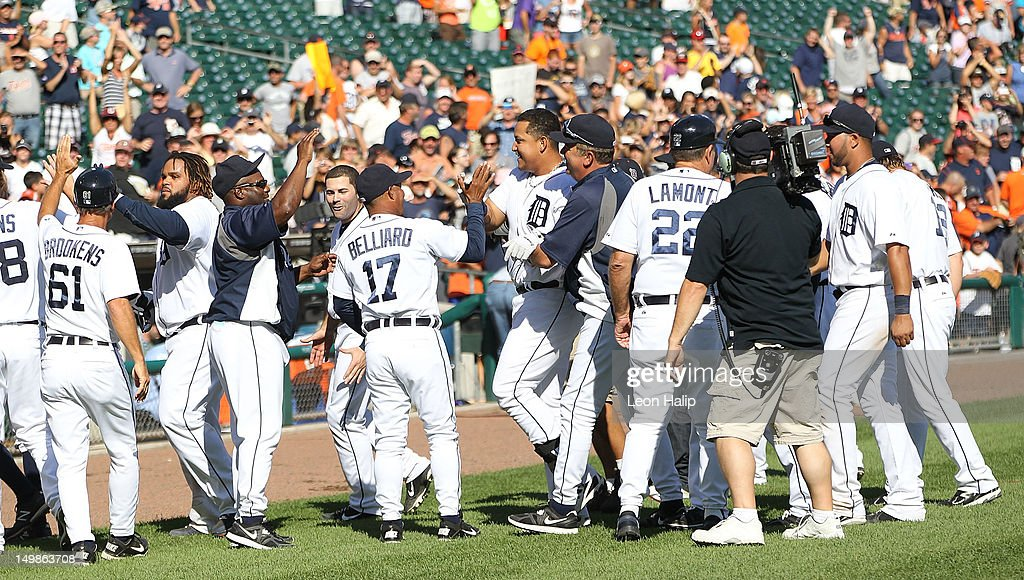 Miguel Cabrera #24 of the Detroit Tigers celebrates with his teammates his game winning two run home in the tenth inning scoring Omar Infante #4 to give the Tigers a 10-8 win over the Cleveland Indians at Comerica Park on August 5, 2012 in Detroit, Michigan. The Tigers defeated the Indians 10-8.