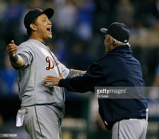 Miguel Cabrera of the Detroit Tigers celebrates with Jim Leyland after they defeated the Kansas City Royals 63 to win the American League Central...