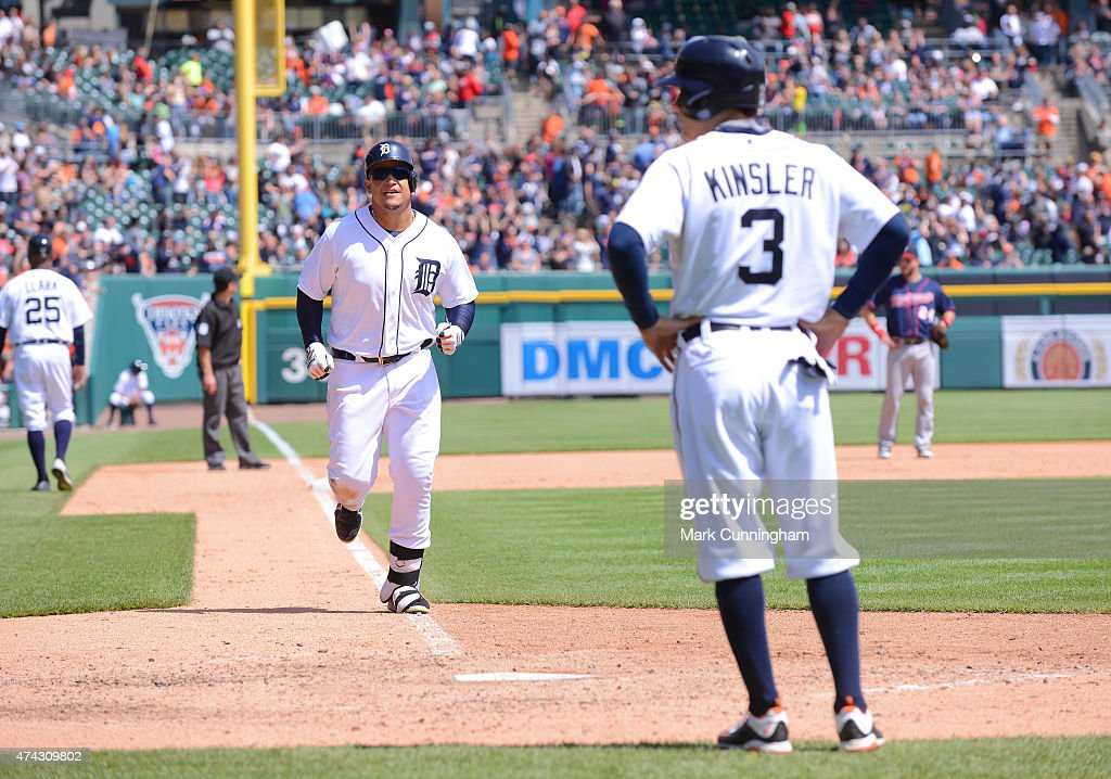 Miguel Cabrera #24 of the Detroit Tigers celebrates with teammate Ian Kinsler #3 after hitting a two-run home run in the bottom of the seventh inning of the game against the Minnesota Twins at Comerica Park on May 14, 2015 in Detroit, Michigan. The Tigers defeated the Twins 13-1.
