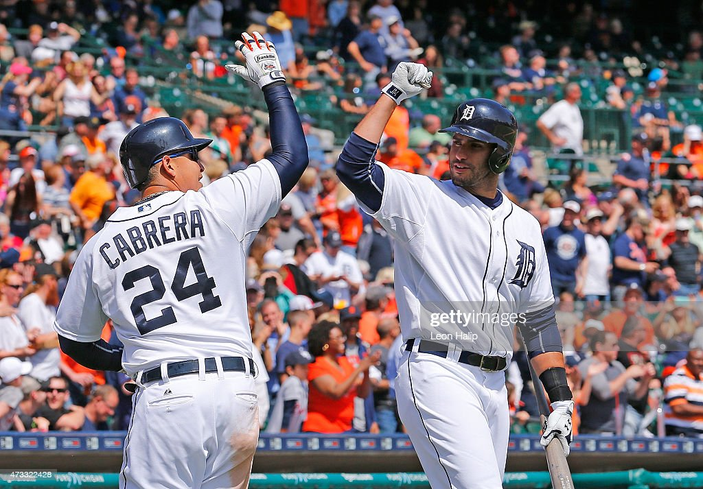 Miguel Cabrera #24 of the Detroit Tigers celebrates with teammate J.D. Martinez #28 after hitting a two run home run in the sixth inning of the game against the Minnesota Twins on May 14, 2015 at Comerica Park in Detroit, Michigan.