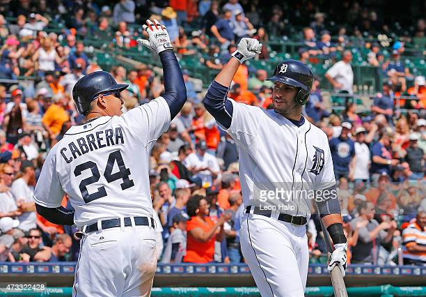 Miguel Cabrera of the Detroit Tigers celebrates with teammate JD Martinez after hitting a two run home run in the sixth inning of the game against...