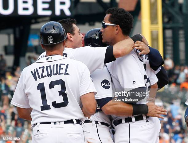 Miguel Cabrera of the Detroit Tigers celebrates with teammates including Ian Kinsler of the Detroit Tigers after taking a basesloaded walk in the...