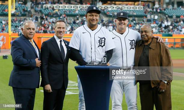 Miguel Cabrera of the Detroit Tigers, center, with General Manager Al Avila, Chairman and CEO Christopher Ilitch, manager A.J. Hinch and former...