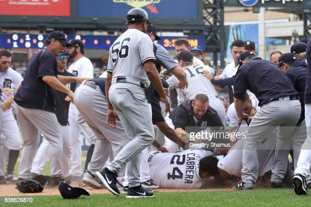 Miguel Cabrera of the Detroit Tigers fights with Aaron Judge of the New York Yankees during a bench clearing fight in the sixth inning at Comerica...