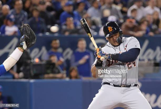Miguel Cabrera of the Detroit Tigers gets out of the way of a high and inside pitch in the fourth inning during MLB game action against the Toronto...
