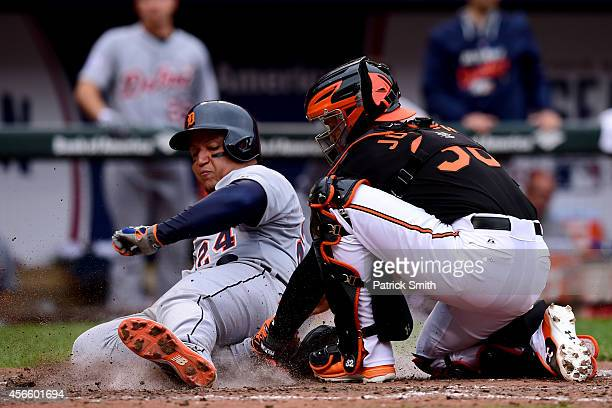 Miguel Cabrera of the Detroit Tigers gets tagged out at home plate by Caleb Joseph of the Baltimore Orioles on a doubled to deep center field hit...