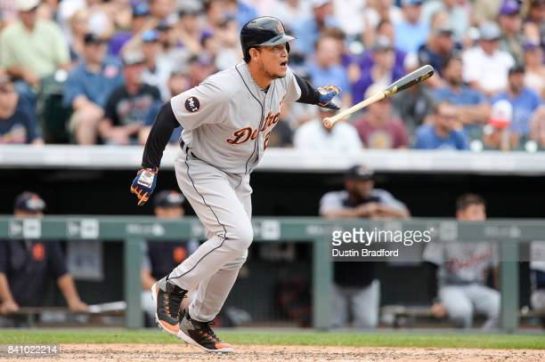 Miguel Cabrera of the Detroit Tigers has an RBI as he grounds into a double play with the bases loaded in the eighth inning of a game at Coors Field...