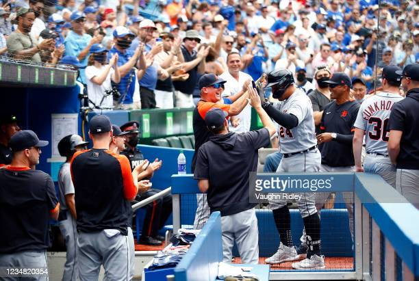 Miguel Cabrera of the Detroit Tigers high fives Manager A.J. Hinch after hitting his 500th career home run in the sixth inning during a MLB game...