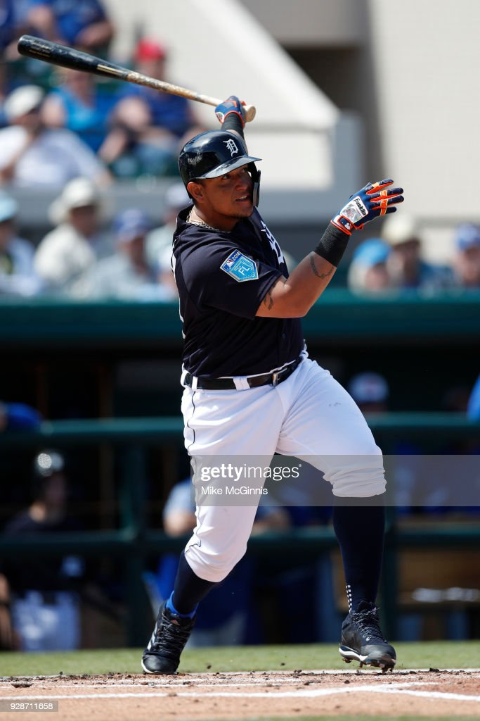 Miguel Cabrera #24 of the Detroit Tigers hits a run-scoring sacrifice fly during the first inning of the spring training game against the Toronto Blue Jays at Joker Marchant Stadium on March 07, 2018 in Lakeland, Florida.