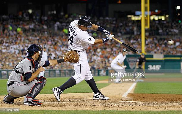 Miguel Cabrera of the Detroit Tigers hits a sixth inning single that scored a run while playing the Minnesota Twins at Comerica Park on August 16,...