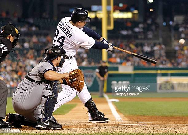 Miguel Cabrera of the Detroit Tigers hits a sixth inning two run home run in front of Lou Marson of the Cleveland Indians at Comerica Park on...