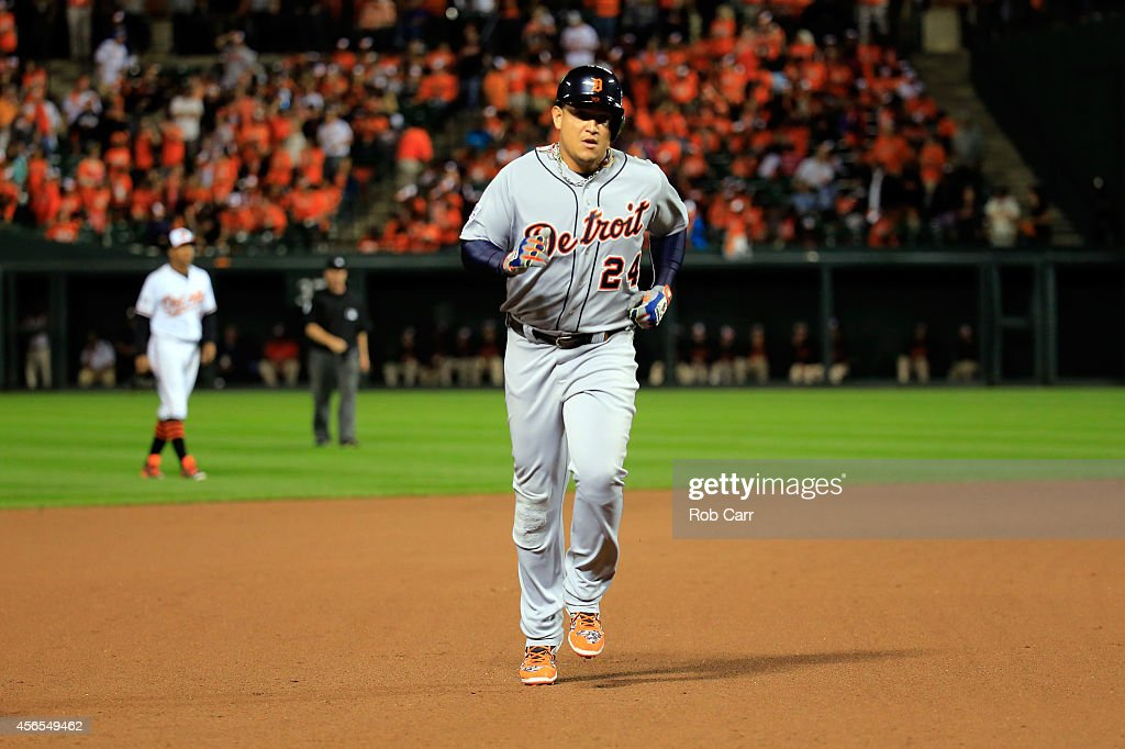 Miguel Cabrera #24 of the Detroit Tigers hits a solo home run in the eighth inning against Darren O'Day #56 of the Baltimore Orioles during Game One of the American League Division Series at Oriole Park at Camden Yards on October 2, 2014 in Baltimore, Maryland.