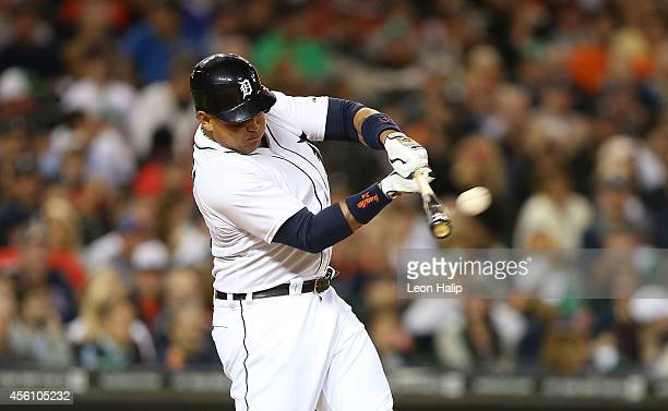 Miguel Cabrera of the Detroit Tigers hits a solo home run to left field during the game against the Minnesota Twins at Comerica Park on September 25...